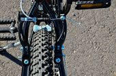 foto of suspension  - Close up of Modern Red Full Suspension Mountain Bike MTB Bicycle - JPG
