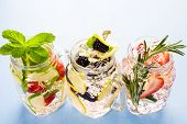 image of infusion  - Fresh infused water made with organic ccitruses and berries - JPG
