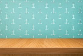 pic of anchor  - Empty wooden table over vintage wallpaper with a pattern of anchor - JPG