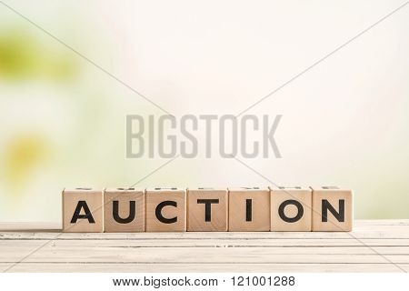 Auction Sign On A Vintage Table