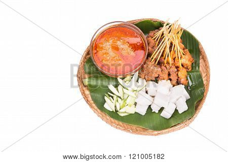 Barbecue Satay Served On Traditional Rattan Plate With Banana Leaf