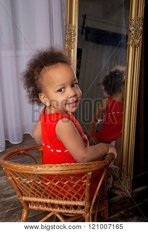 Black Mulatto Baby Girl Front The Mirror.