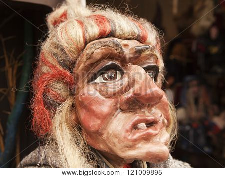 PRAGUE, CZECH REPUBLIC - OCTOBER 7, 2010: A near-lifesize head of a traditional Czech marionette in the likeness of a witch.