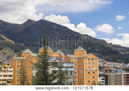 QUITO, ECUADOR - OCTOBER - 2015 - Day urban scene photo of modern buildings and big mountains at background in a district of Quito city the capital of Ecuador in South America