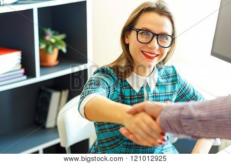 Young Business Woman With Arm Extended To Handshake