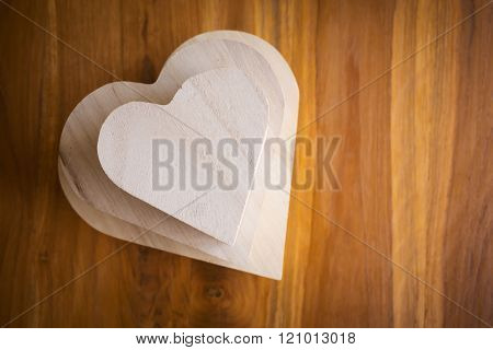 Wood Box Shaped Heart On Brown Wooden Background