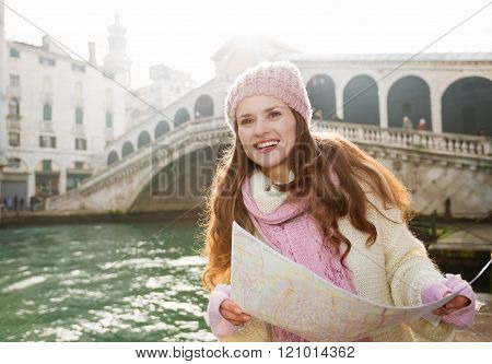 Woman Tourist With Map Near Rialto Bridge Looking On Grand Canal