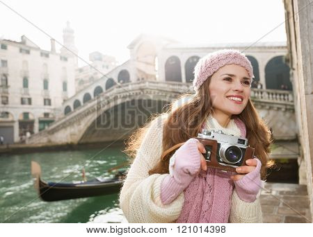 Happy Woman Tourist With Retro Photo Camera Near Rialto Bridge