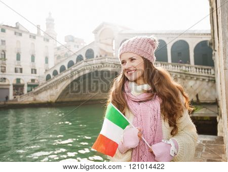 Happy Woman Tourist With Italian Flag In Front Of Rialto Bridge