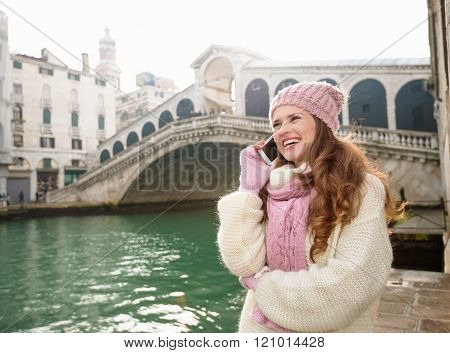 Happy Woman Tourist Talking Cell Phone In Front Of Rialto Bridge