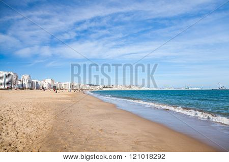 Tangier Public Beach With Walking Local People