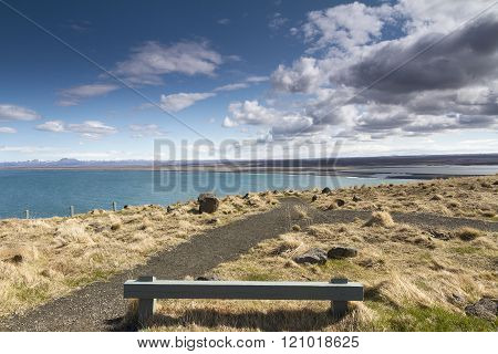 Wooden Bench Next To A Beautiful Coast Line In Iceland