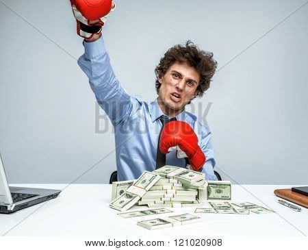 Business person boxing punching towards camera ready to fight.