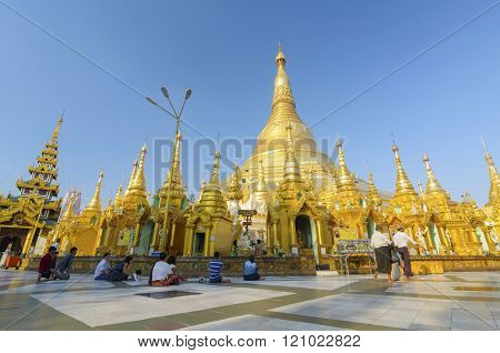 Yangon, Myanmar – December 29 : Unidentified People Walking Around  In Shwedagon Pagoda On December,