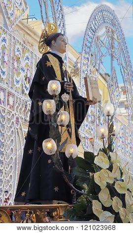 Modugno , Italy - 23 September 2013: statue of the patron saint in a procession with luminarie in the background