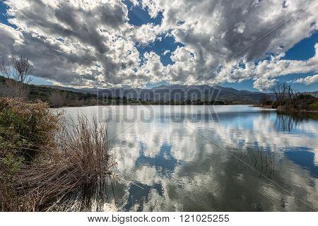 Clouds Reflected In Lac De Padula Near Oletta In Corsica