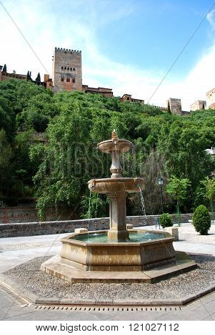 Stone fountain by Alhambra, Granada.