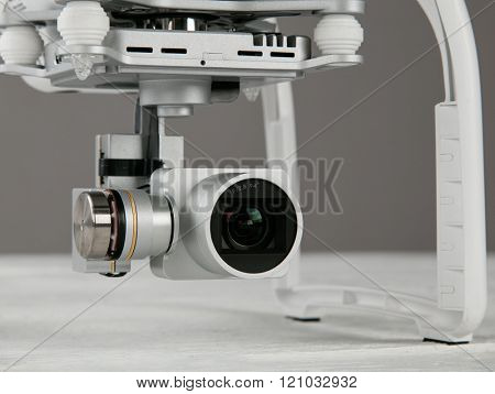 White drone. Quadrocopter with photo camera, close-up.