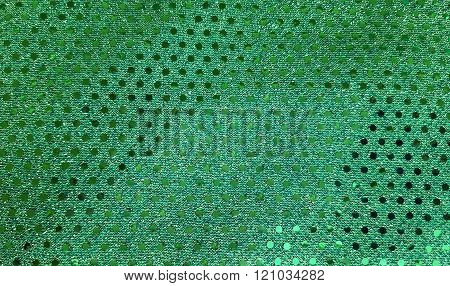 Close up of green fabric with shiny sequins. ** Note: Soft Focus at 100%, best at smaller sizes