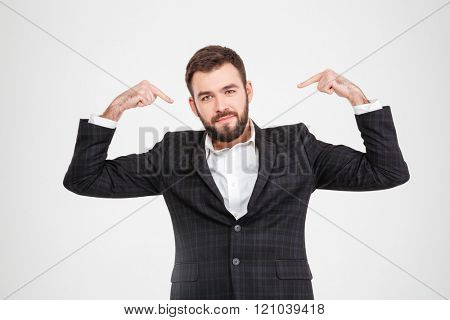 Proud businessman pointing fingers at herself isolated on a white background