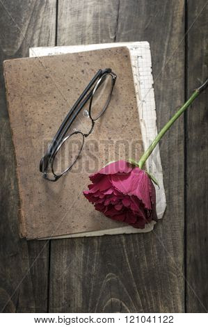 Still Life With Vintage Notebook And Rose