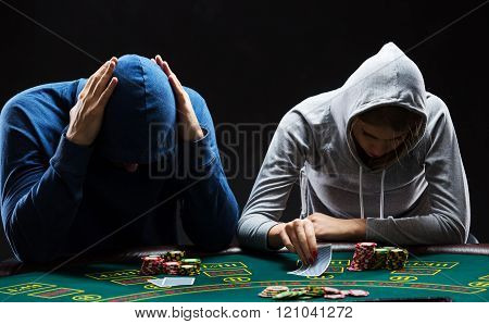 Two professional poker players sitting at a table