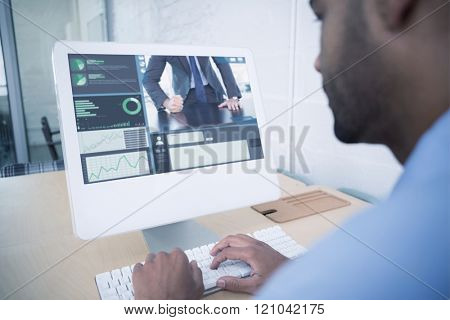 Angry businessman thump the table against businessman using computer at desk