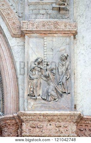 BOLOGNA, ITALY - JUNE 04: Visitation of the Virgin Mary by Giacomo Scilla, left door of San Petronio Basilica in Bologna, Italy, on June 04, 2015