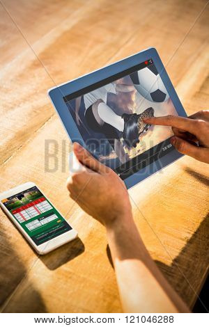 View of lecture app against over shoulder view of casual man using tablet
