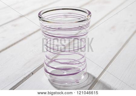 Crystal Drinking Glass With Purple Looping Streak Design