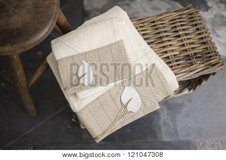 Pair Of White Towels With Embroidered Brown Flower Design