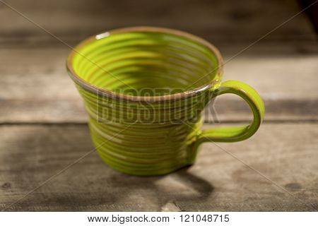 Green Teacup On A Wooden Surface