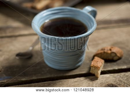 Blue Cup Containing Coffee Or Tea With Spoon And Biscuits