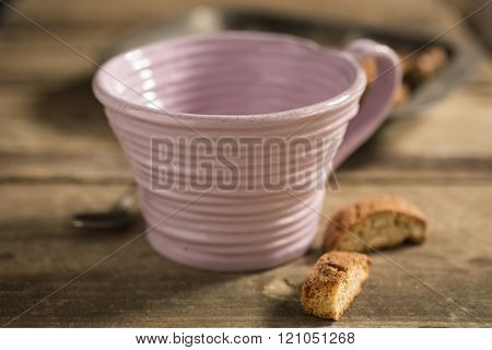 Empty Pink Teacup, Framed At Center, Between Spoon And Biscuits