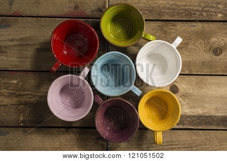 High Angle Shot Of Seven Teacups Of Various Colors