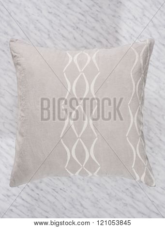 Close Up Of Square Gray Pillow With Shadow On Marble
