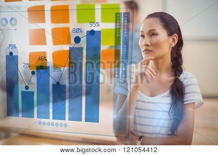 Percentages graphical representation against concentrated businesswoman looking post its on the wall