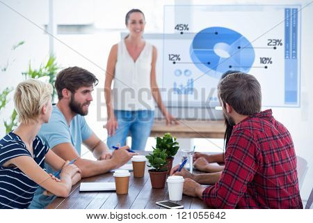 Casual businesswoman giving presentation to her colleagues against global business interface
