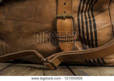 Strap Of Leather Bag Fastened To Metal Buckle