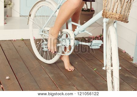 Woman Bare Feet Near The Blue Bicycle