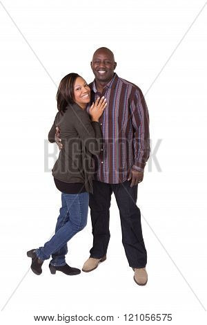 A middle aged couple standing close and interacting. Isolated on white