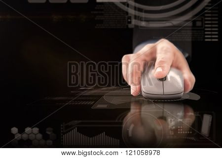 Businessman in suit using mouse against black and grey interface