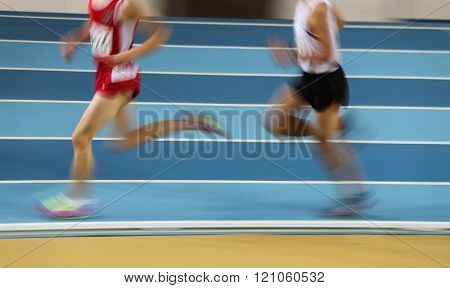 Blured Athletes Run In Track And Field