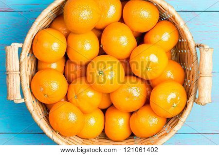 Fresh Ripe Juicy Clementines In A Wicker Basket