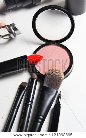 Red Lipstick And Mix Of Make Up Brushes