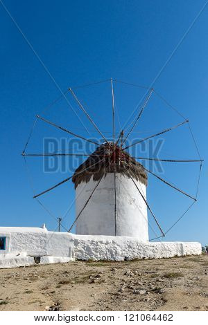 White windmill and blue sky on the island of Mykonos, Greece
