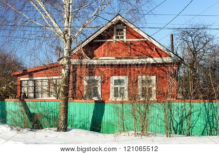 Old Red Wooden House In Winter