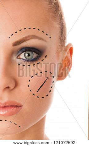 Beauty portrait of woman with perfect makeup, smokey eyes, full lips thinking about anti-aging facial surgery.