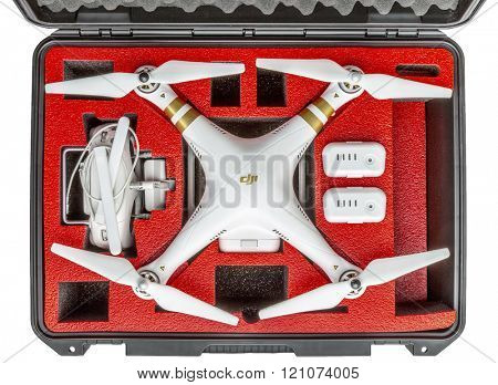 Fort Collins, CO, USA - March 09, 2016:  DJI Phantom 3 quadcopter drone with a set of propellers, radio controller, and spare batteries in a waterproof case - top view on white background