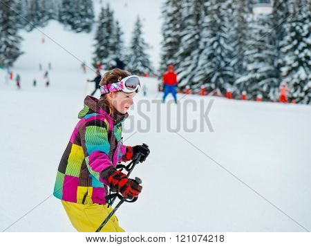 Happy kid skiing at the winter resort